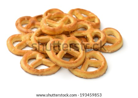 Salted pretzels isolated on white - stock photo