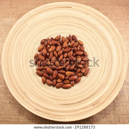 Salted Roasted Almonds Nuts on Wooden Surface/Roasted Almonds/Nuts - stock photo