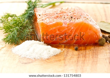salted salmon with salt, pepper and spices - stock photo