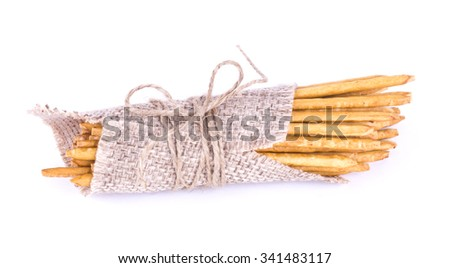 salted sticks tied. Straws in sackcloth isolated. Salty sticks wrapped. - stock photo