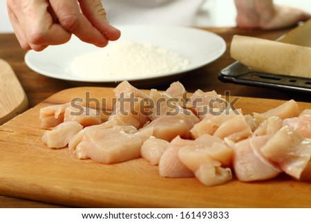 Salting meat. Making oven baked corn flake crumbs chicken nuggets. Series. - stock photo