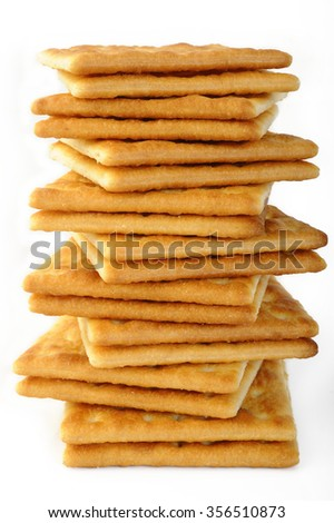 salty crackers on white background - stock photo