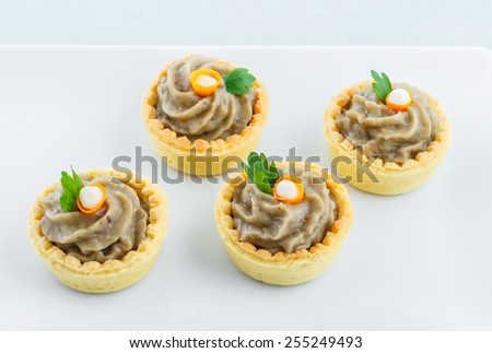 Salty mini tartlets stuffed with baba ganoush - stock photo
