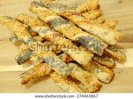 salty sticks with sesame and poppy seeds, Bread sticks or Pretzel sticks - stock photo