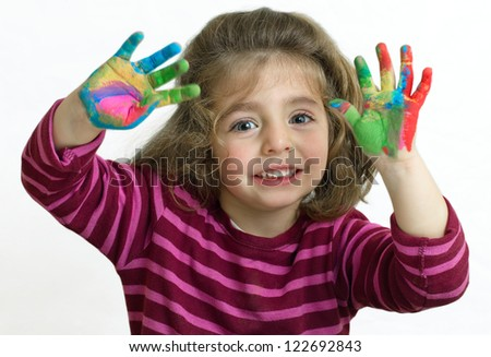 saluting girl with arms raised and her hands painted - stock photo