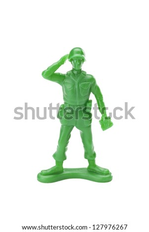 Saluting toy soldier isolated in a white background - stock photo