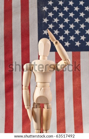 Saluting Wooden Art Doll - stock photo