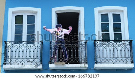SALVADOR, BAHIA, BRAZIL:09 DEC 2013: An US singer Michael Jackson statue are displayed in a store at Pelorinho square on 09th Decenber 2013,in Brazil. Jackson recorded a video clip on this square. - stock photo