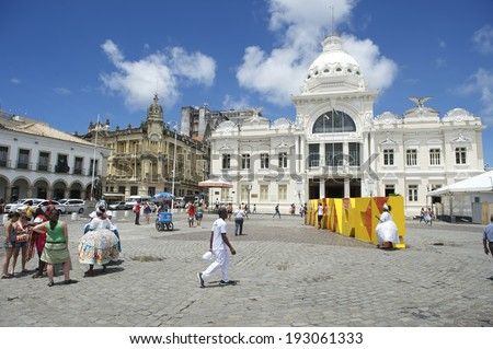 SALVADOR, BRAZIL - MARCH 6, 2014: Tourists and locals mingle in the Praca Municipal, the main entrance to the tourist center of Pelourinho in Cidade Alta. - stock photo
