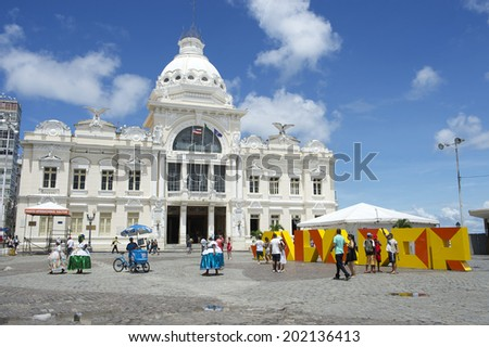 SALVADOR, BRAZIL - MARCH 06, 2014: Tourists and locals mingle in the Praca Municipal, the main entrance to the tourist center of Pelourinho in Cidade Alta. - stock photo