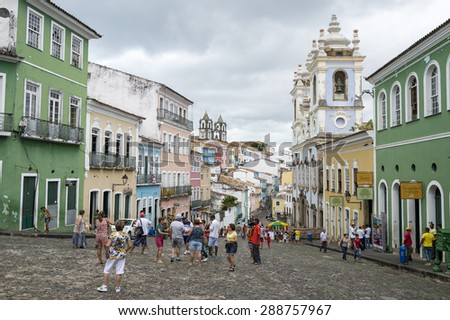 SALVADOR, BRAZIL - MARCH 12, 2015: Tourists gather in a plaza surrounded by colonial buildings in the historic district of Pelourinho. - stock photo