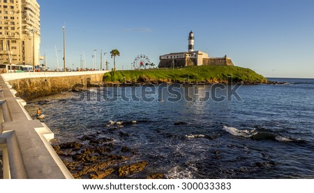 SALVADOR, BRAZIL - MAY 7: Panoramic view of Bahia de Todos os Santos Bay in Salvador, BA, Brazil showcasing the historic architecture of Farol da Barra lighthouse on a sunny summer day on May 7, 2015. - stock photo