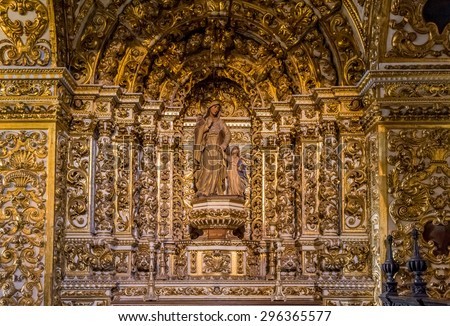 SALVADOR, BRAZIL - MAY 10: The Baroque architecture of Convento de Sao Francisco Church in Salvador, BA, Brazil, with its carved walls, Saint Images, and Altars covered in pure gold on May 10, 2015. - stock photo