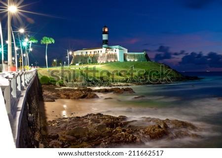 Salvador da Bahia, Brazil - Barra Lighthouse at night. - stock photo