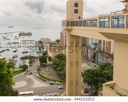 SALVADOR DE BAHIA, BRAZIL - CIRCA MAY 2015. In the foreground, the Elevador Lacerda (Elevator) that joins the high and low part of the city. The building below is the Mercado Modelo, a famous Market. - stock photo