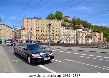 salzburg, austria - april 25: snapshot of the streets of salzburg, austria, limousine in the foreground. shot taken on april 25th, 2015 - stock photo