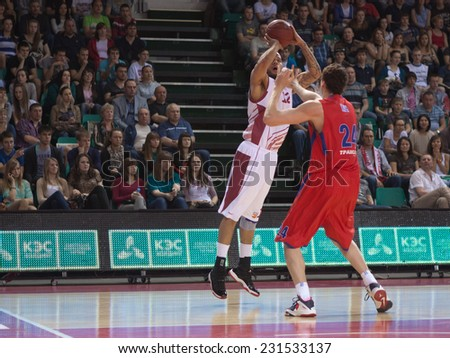SAMARA, RUSSIA - APRIL 21: Andre Smith of BC Krasnye Krylia throws a ball in a basket during a BC CSKA game on April 21, 2013 in Samara, Russia. - stock photo