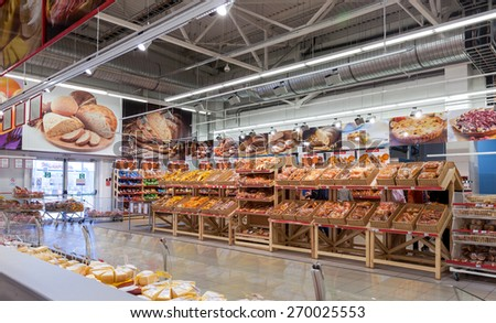 SAMARA, RUSSIA - APRIL 12, 2015: Bakery products ready to sale in the new hypermarket Magnet. Russia's largest retailer. It was founded in 1994 in Krasnodar - stock photo