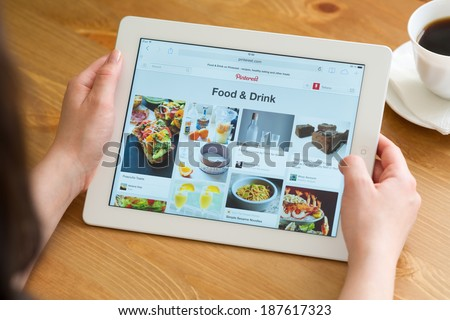 Samara, Russia - April 08, 2014: Close up of pinterest website on a ipad screen. Pinterest announces a new application for mobile devices - stock photo