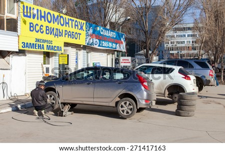 SAMARA, RUSSIA - APRIL 11, 2015: New tyres are mounted on a car - stock photo