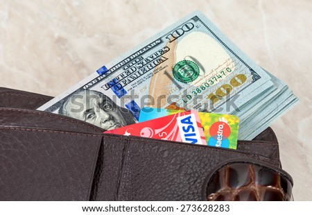 SAMARA, RUSSIA - APRIL 17, 2015: Wallet with american dollars and credit cards - stock photo