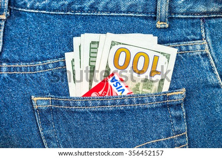SAMARA, RUSSIA - DECEMBER 23, 2015: Credit card Visa with US dollars sticking out of the back jeans pocket - stock photo