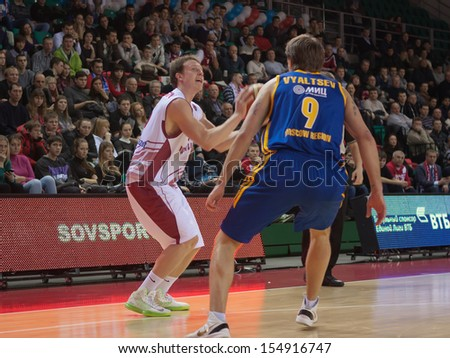 SAMARA, RUSSIA - DECEMBER 17: Dmitriy Kulagin of BC Krasnye Krylia, with ball, is on the attack during a BC Khimki game on December 17, 2012 in Samara, Russia. - stock photo