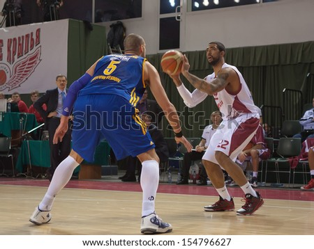 SAMARA, RUSSIA - DECEMBER 17: Jeremiah Massey of BC Krasnye Krylia, with ball, is on the attack during a BC Khimki game on December 17, 2012 in Samara, Russia. - stock photo