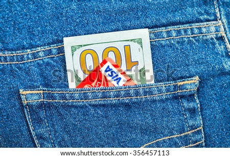 SAMARA, RUSSIA - DECEMBER 23, 2015: One hundred dollars bill and Credit card Visa sticking out of the back jeans pocket - stock photo