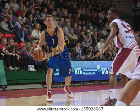 SAMARA, RUSSIA - DECEMBER 17: Vitaly Fridzon of BC Khimki, with ball, is on the attack during a BC Krasnye Krylia game on December 17, 2012 in Samara, Russia. - stock photo