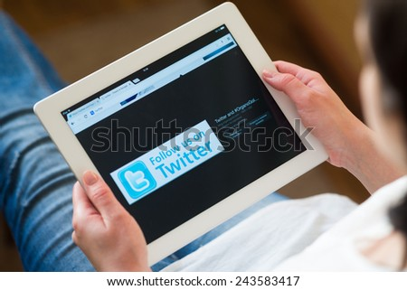 "Samara, Russia - January 12, 2015:   Twitter is an online social networking and microblogging service that enables users to send and read ""tweets"",  limited to 140 characters. - stock photo"