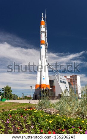 "SAMARA, RUSSIA - JUNE 14: Real ""Soyuz"" type rocket as monument on June 14, 2013 in Samara. Rocket height together with building - 68 meters, weight - 20 tons. The monument was unveiled on 2001 - stock photo"