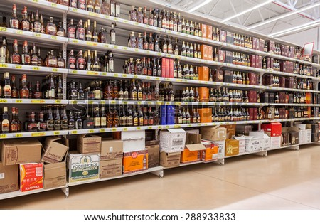 SAMARA, RUSSIA - JUNE 13, 2015: Showcase alcoholic beverages at the hypermarket Auchan. French distribution network Auchan unites more than 1300 shops - stock photo