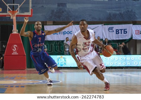SAMARA, RUSSIA - MAY 20: Aaron Miles of BC Krasnye Krylia, with ball, is on the attack during a BC CSKA game on May 20, 2013 in Samara, Russia. - stock photo