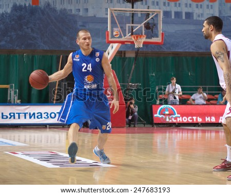 SAMARA, RUSSIA - MAY 11: Andrey Kuzemkin of BC Enisey, with ball, is on the attack during a BC Krasnye Krylia game on May 11, 2013 in Samara, Russia. - stock photo