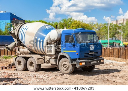 SAMARA, RUSSIA - MAY 7, 2016: Concrete mixer truck KAMAZ at the construction of road - stock photo