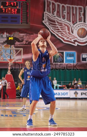 SAMARA, RUSSIA - MAY 11: Elmedin Kikanovic of BC Enisey throws from the free throw line in a game against BC Krasnye Krylia on May 11, 2013 in Samara, Russia. - stock photo