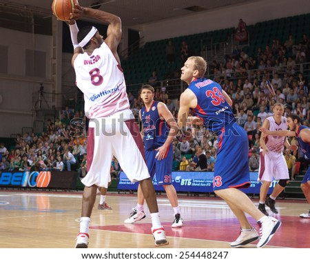 SAMARA, RUSSIA - MAY 19: Lamayne Wilson of BC Krasnye Krylia throws the ball in a basket during a BC CSKA game on May 19, 2013 in Samara, Russia. - stock photo