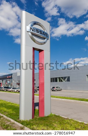 SAMARA, RUSSIA - MAY 11, 2015: Official dealership sign of Nissan. Nissan is a Japanese multinational automaker headquartered in Nishi-ku, Yokohama, Japan - stock photo