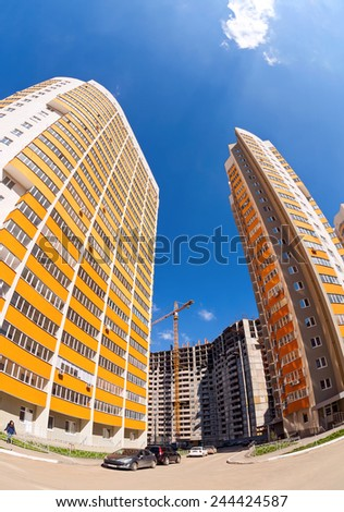 SAMARA, RUSSIA - MAY 8, 2014:Tall apartment buildings under construction  against a blue sky background - stock photo