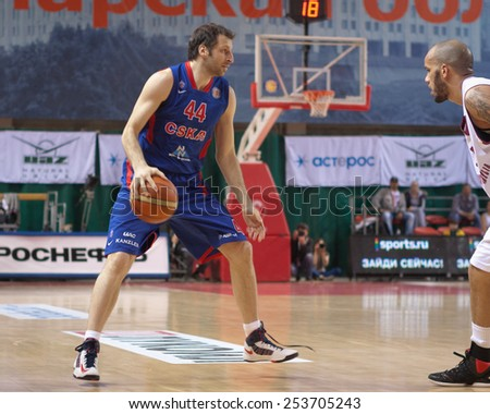 SAMARA, RUSSIA - MAY 19: Theodoros Papaloukas of BC CSKA with ball goes against a BC Krasnye Krylia player on May 19, 2013 in Samara, Russia. - stock photo