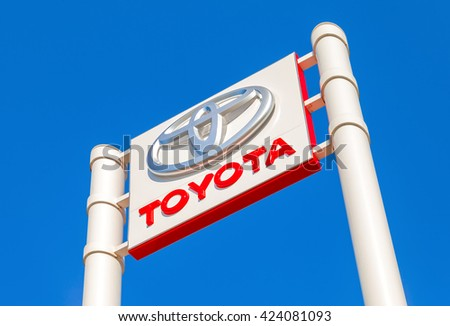 SAMARA, RUSSIA - MAY 14, 2016: Toyota automobile dealership sign against the blue sky background. Toyota Motor Corporation is a Japanese automotive manufacturer - stock photo