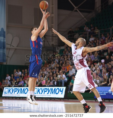 SAMARA, RUSSIA - MAY 19: Victor Khryapa of BC CSKA throws the ball in a basket during a game against BC Krasnye Krylia on May 19, 2013 in Samara, Russia. - stock photo