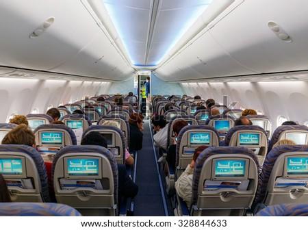SAMARA, RUSSIA - 17 NOVEMBER, 2013: Passengers in the interior of the Boeing - stock photo