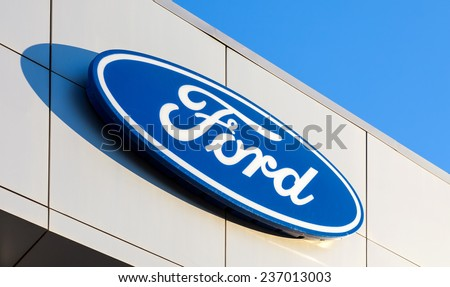 SAMARA, RUSSIA - NOVEMBER 24, 2013: The emblem Ford on the office of official dealer. Ford Motor Company is an American multinational automaker headquartered in Dearborn, Michigan, US - stock photo