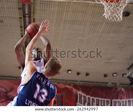 SAMARA, RUSSIA - OCTOBER 22: Aaron Miles of BC Krasnye Krylia, with ball, is on the attack during a BC Triumph game on October 22, 2013 in Samara, Russia. - stock photo