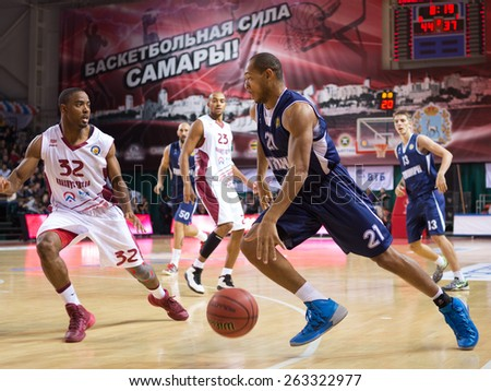 SAMARA, RUSSIA - OCTOBER 22: Jeremy Chappell of BC Triumph with ball goes against a BC Krasnye Krylia player on October 22, 2013 in Samara, Russia. - stock photo