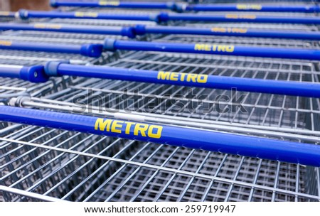 SAMARA, RUSSIA - OCTOBER 4, 2014: Large empty blue shopping cart Metro store. Metro Group is a German global diversified retail group based in Dusseldorf - stock photo