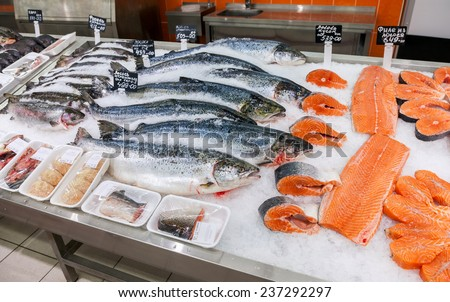 SAMARA, RUSSIA - OCTOBER 26, 2014: Raw fish ready for sale in the supermarket Magnit. One of largest food retailer in Russia - stock photo