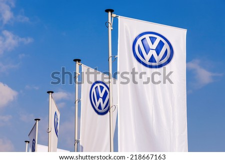 SAMARA, RUSSIA - SEPTEMBER 21, 2014: The flags of Volkswagen over blue sky. Volkswagen is the biggest German automaker and the third largest automaker in the world - stock photo